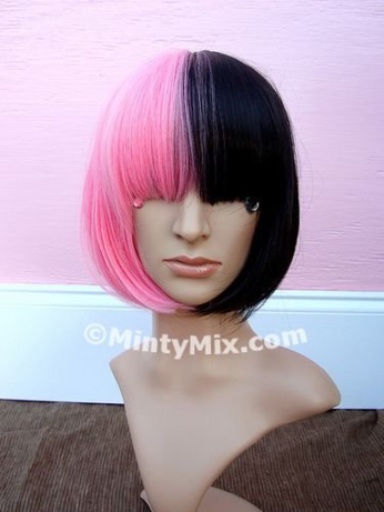 A two-tone wig, pink on the left and black on the right, that covers the wearer's eyes.
